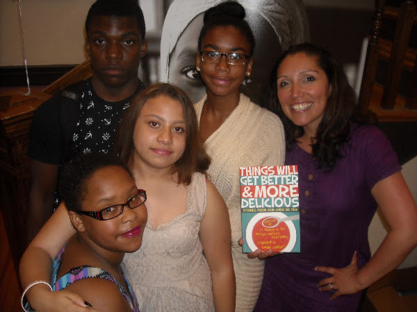 Author and partner teacher Jennifer De Leon poses with her students during Monday night's release party for Things Will Get Better and More Delicious.
