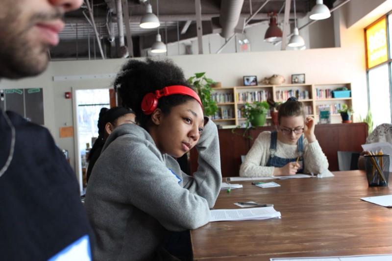 826 Boston students during a fiction and poetry workshop
