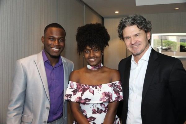 Dave Eggers with student emcees Sadrack and Betty
