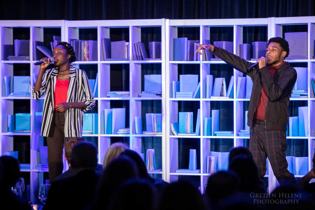 Students Robentina and Victor performing a song onstage.