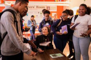 Julia Alvarez signing books for students.