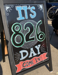 A sandwich board promoting 826 Day sits outside the Egleston Tutoring Center.