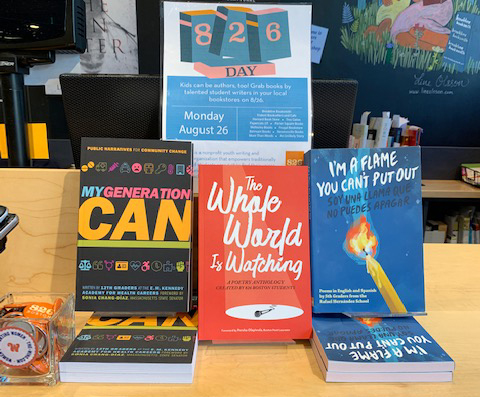 New student-authored releases are displayed in a local bookstore.