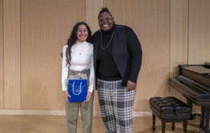 Boston's first Youth Poet Laureate, Allondra (left), poses with Boston Poet Laureate Porsha Olayiwola (right).