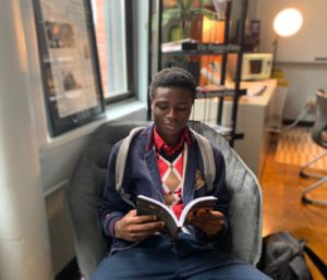 A student reads at the Jeremiah E. Burke High School